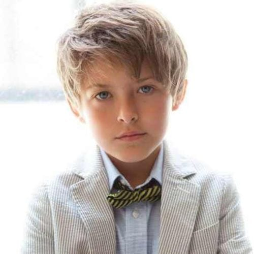 Top of The Chartsboys haircuts– Layered Hairstyle with Bangs