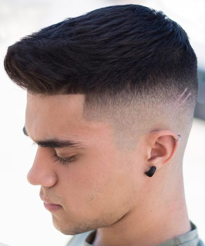 Line up and Disconnected high skin fade with a Pompadour