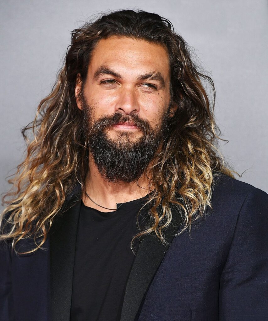 Long and Textured feathered hair men